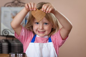 Daughter holding ginger bread heart
